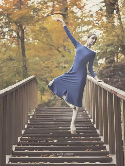 blue dressed ballerina girl is dancing in the nature