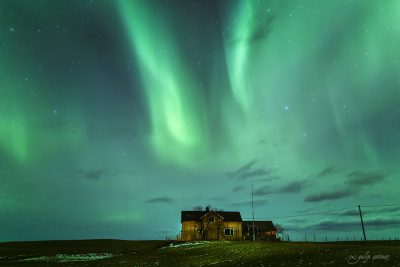 northern lights over the old house in lofoten, norway