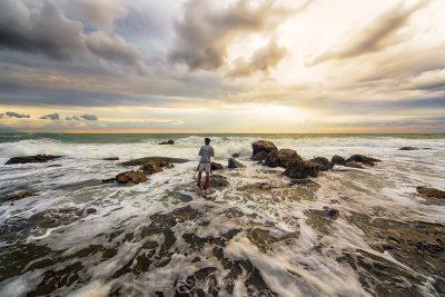 photographer trying to take a photograph against waves in bursa, turkiye