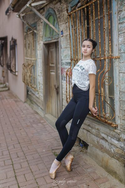 ballerina girl is walking in the street