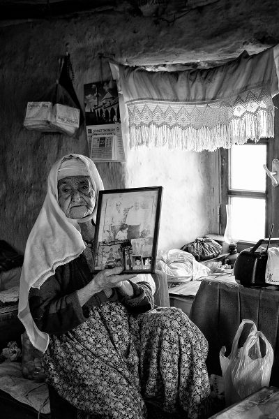 old woman shows her memories in the frame