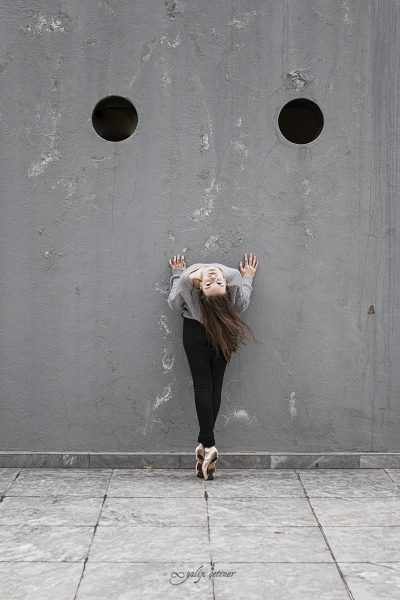 ballerina girl staring from the wall