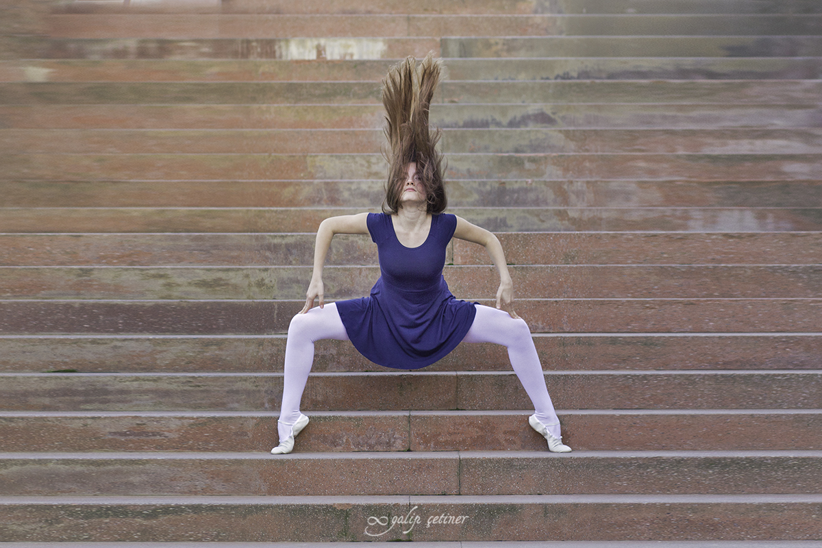ballerina girl is in the action on the stairs