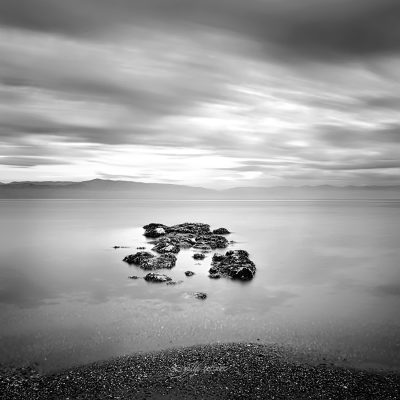 longexposure shot of the rocks in the sea