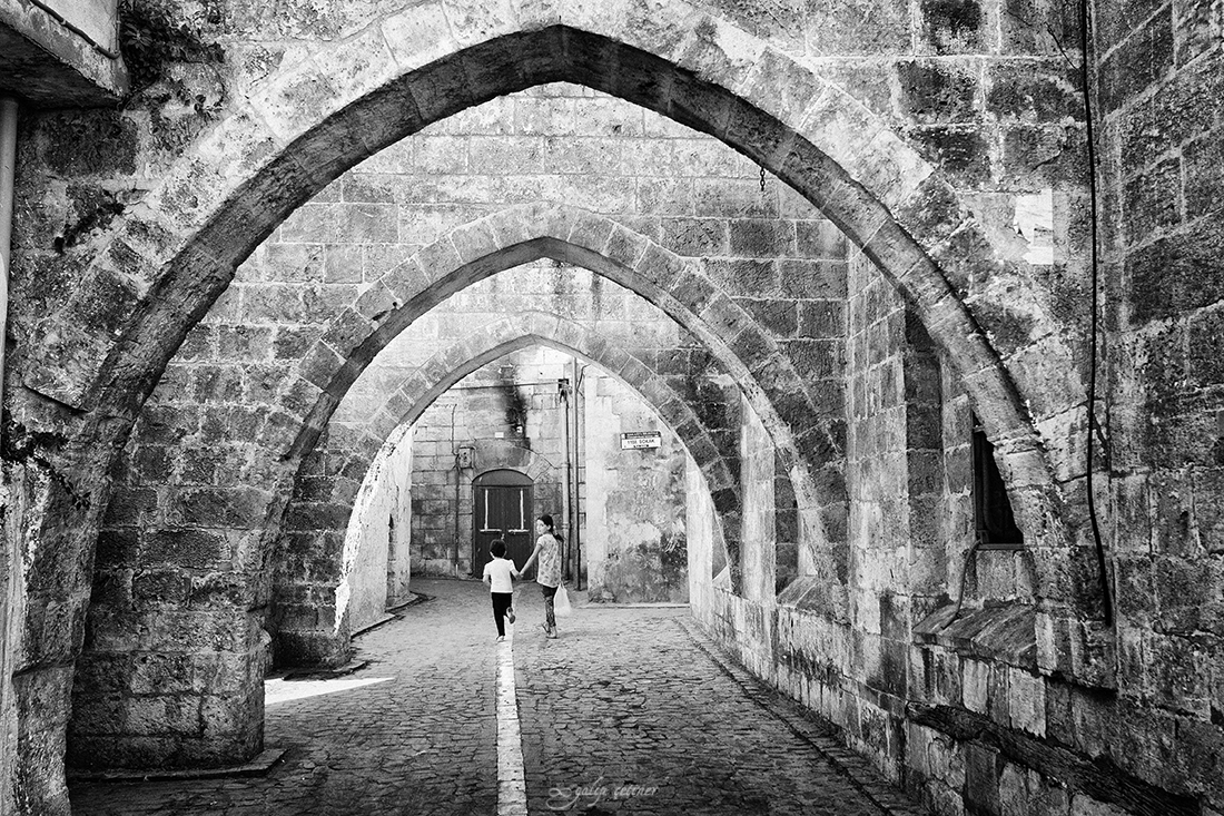 children walking in the street of the old city