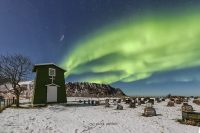 northern lights over the cemetery in fredvang, lofoten, norway