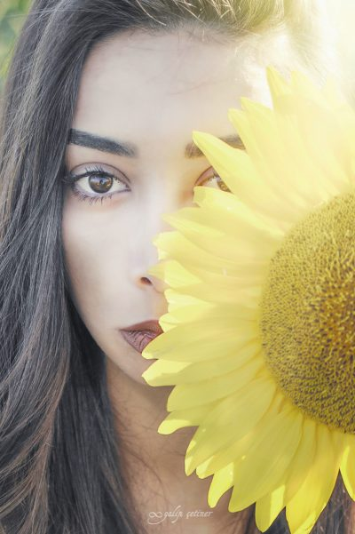 the portrait of the beautiful girl with the sunflower