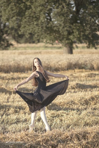 black dressed ballerina girl in the wheat field