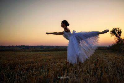 white dressed ballerina in the sunset