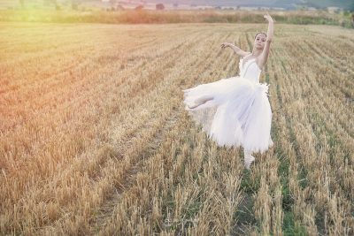 white dressed ballerina in the wheat field