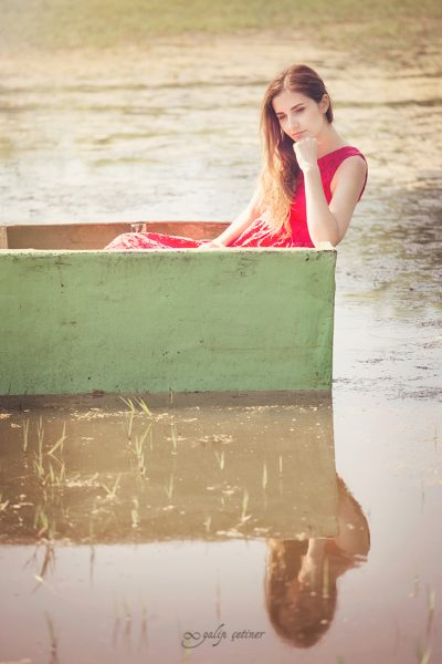 the beautiful sad girl in the boat