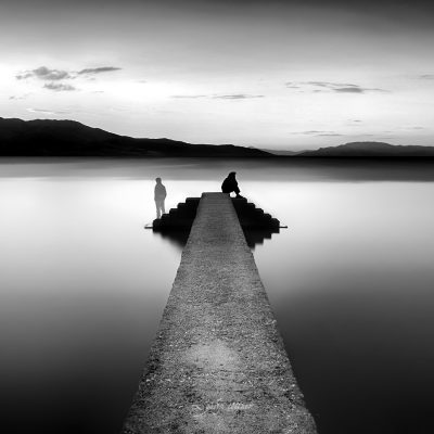 separate couple on the pier in longexposure